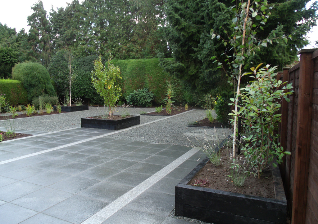 Granite patio landscaped garden ashwood services for Outdoor patio landscaping